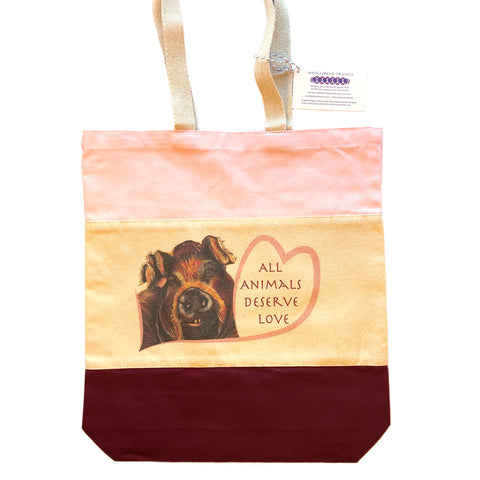Rescued Pig tote bag with maroon and pink panels. Bella is a pig that lives at Loving Farm Animal Sanctuary in California