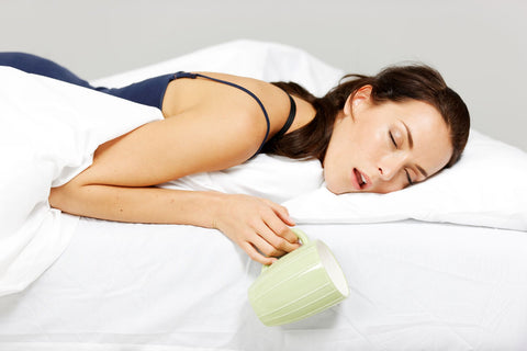 Check the wet areas of the mattress first, woman spilling drink in bed while sleeping