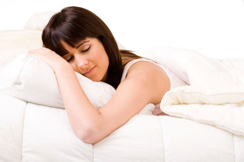 Put in the time when breaking in a new mattress, woman sleeping in warm bed