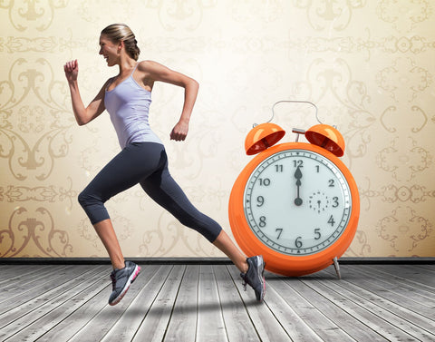 Excercise instead of hitting the snooze button when waking up, woman jogging in front of alarm clock