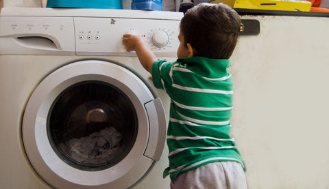 How to wash a bamboo pillow, boy playing with controls of washing machine