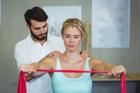 Physical therapy for shoulder pain at night, woman getting physical therapy session for her shoulder