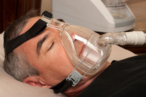 CPAP machines can make you feel uncomfortable while sleeping, man sleeping with CPAP mask on
