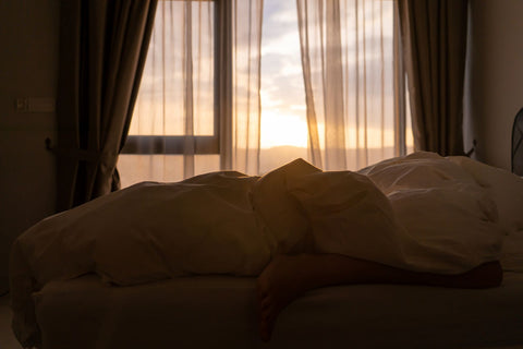 Why do I love to sleep so much, woman in bed at sunrise still sleeping