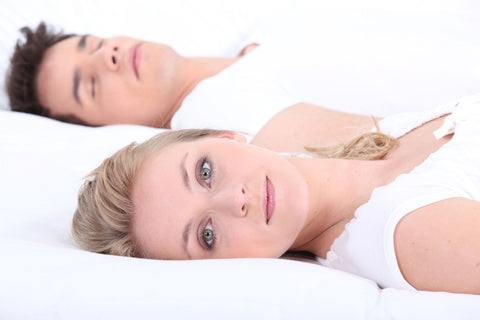 What Experts Say on How to Sleep With Your Eyes Open, woman sleeping with eyes open