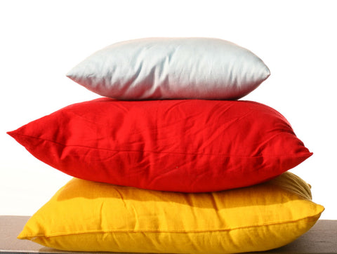 What is a decorative pillow? Pile of different pillows