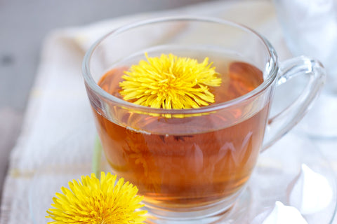 Drink a warm beverage when trying to sleep while having a cold, hot tea with flower on top