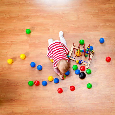 Playtime is important of sleep routine in babys, infant playing with toys