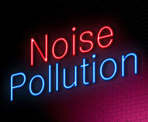 Sleeping in noisy environments, neon light sign saying noise pollution