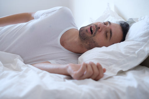 How to stop mouth breathing while sleeping, man sleeping with open mouth