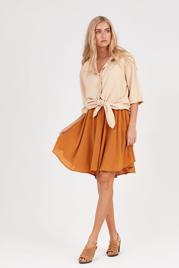 FLUTED ASYMMETRIC SKIRT - RUST