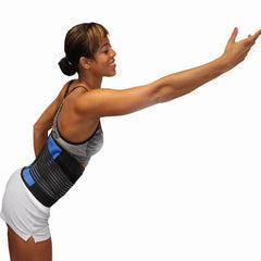 Woman demonstrating freedom of movement with the spinal blue support