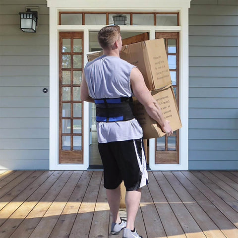 Delivery man wearing a Spinal Blue Support