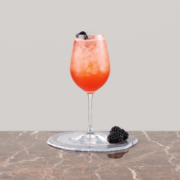pink-cocktail-with-cassis-syrup-and-strawberries-red-mocktail