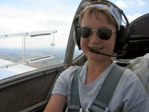Dave's son, Will, wearing his dad's Randolph Aviators midflight. Looking great, Will!