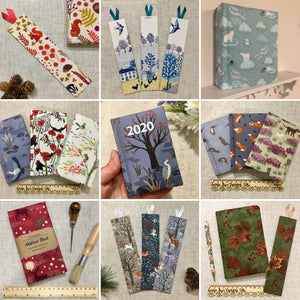 Fabric crafted bookmarks and notebooks