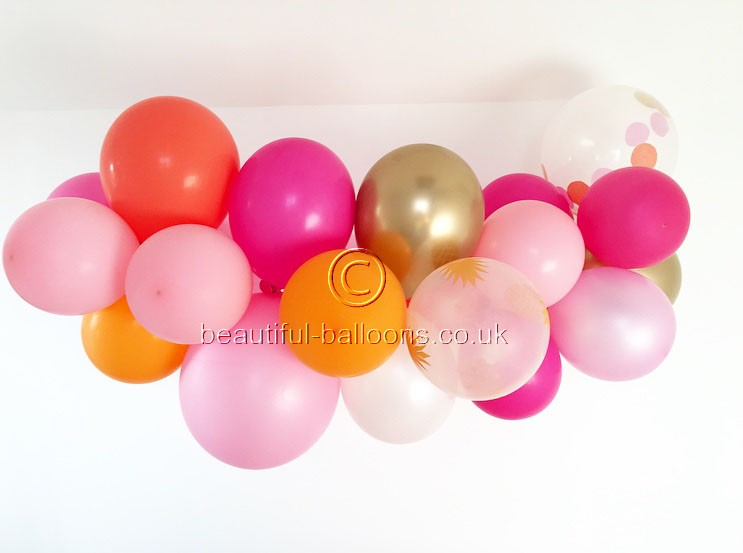 Flamingo Gold Cloud Garland with confetti and pineapple balloons