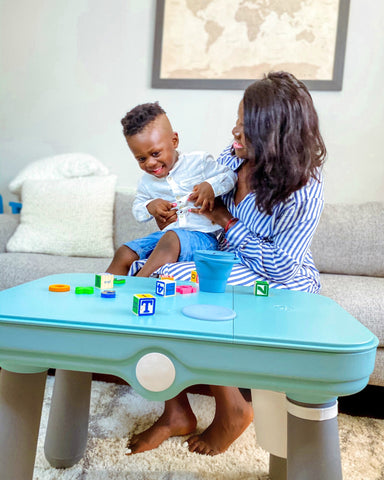 Eizzy Baby founder Assie and her son Noah during playtime