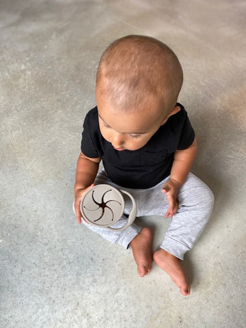 Child Development Specialist Cathy Wojcik's son using his dust-resistant Eizzy Baby Snack Cup