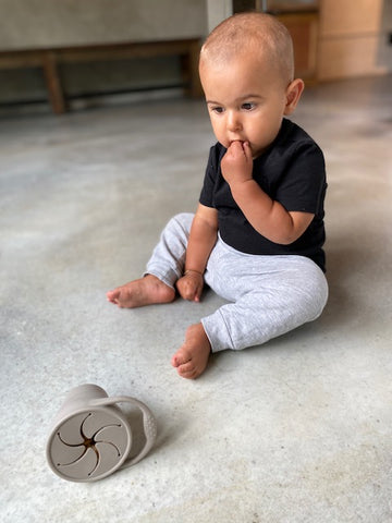 Child Development Specialist Cathy Wojcik's son playing with an Eizzy Baby Snack Cup