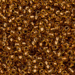 50g Toho Round Seed Bead 11/0 Copper Lined Light Topaz (744)