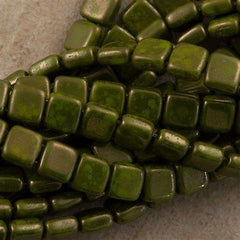 50 CzechMates 6mm Two Hole Tile Beads Opaque Olive Moon Dust (53420MD)