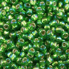 Toho Round Seed Beads 6/0 Silver Lined Peridot AB 5.5-inch tube (2027)