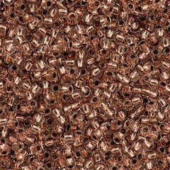 50g Toho Round Seed Beads 11/0 Copper Lined Crystal (740)