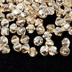 144 Swarovski 5328 Xilion 4mm Bicone Bead Crystal Golden Shadow (001 GSHA)