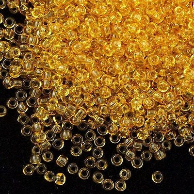 Toho Round Seed Beads 6/0 Transparent Amber 5.5-inch tube (2)
