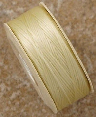 Size D Nymo Nylon Cream Thread 64 yard bobbin