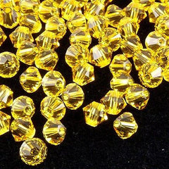 24 Swarovski 5328 Xilion 6mm Bicone Bead Light Topaz (226)