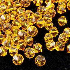 144 Swarovski 5328 Xilion Crystal 3mm Bicone Bead Sunflower (292)