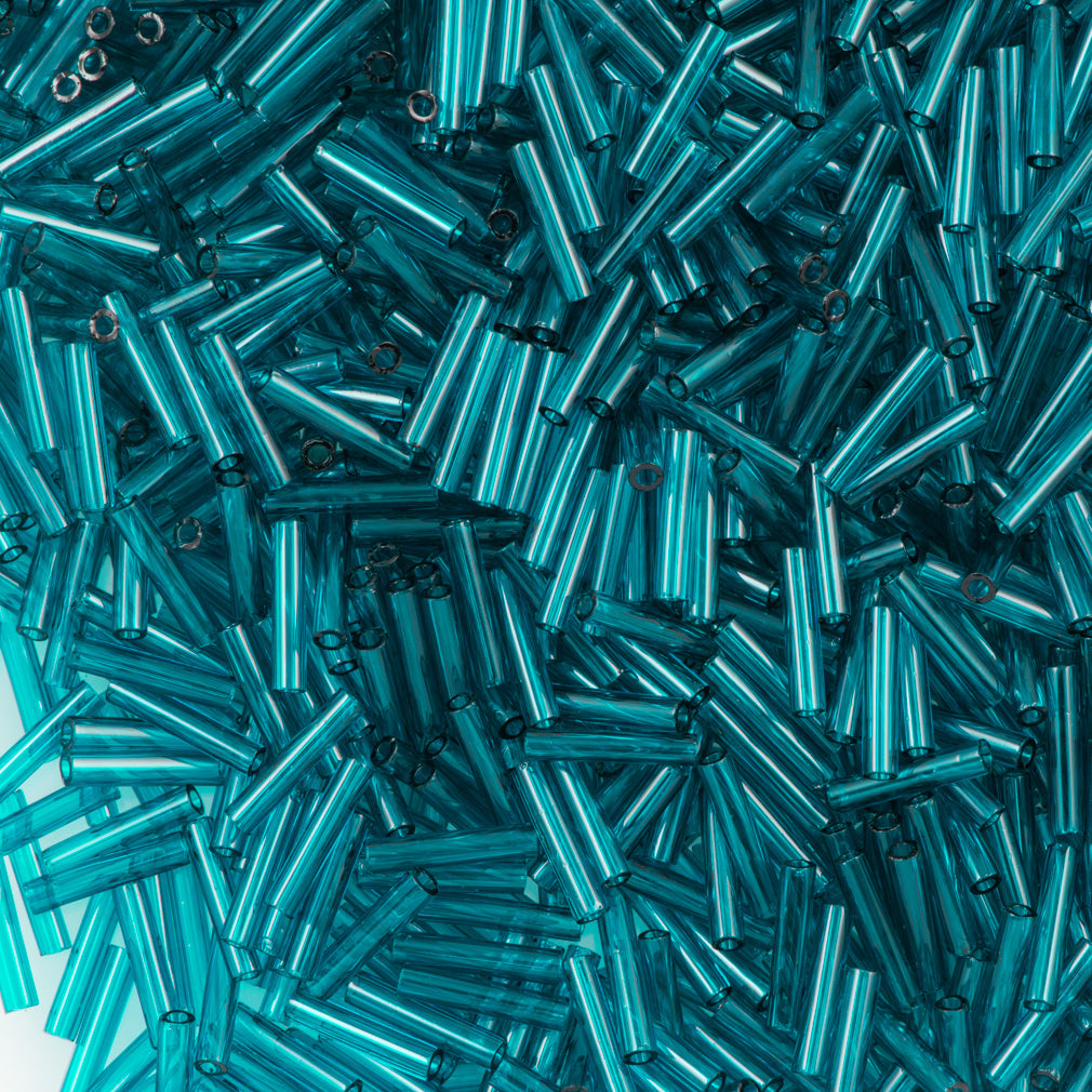 Toho 9mm Bugle Bead Transparent True Teal 15g (7BD)