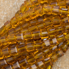 100 Faceted Cube 4mm Light Amber Beads
