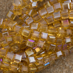 100 Faceted Cube 4mm Light Topaz AB Beads