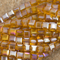 100 Faceted Cube 4mm Golden Tan AB Beads