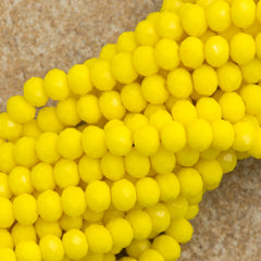 100 Faceted Rondelle 3x4mm Opaque Yellow Beads
