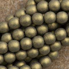100 Czech 6mm Pressed Glass Round Beads Metallic Suede Gold (79080)