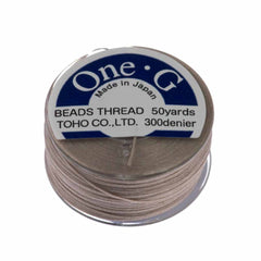 Toho One-G Nylon Beige Thread 50 yard bobbin