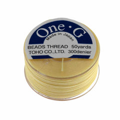 Toho One-G Nylon Light Yellow Thread 50 yard bobbin