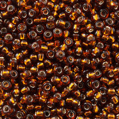 Toho Round Seed Bead 6/0 Silver Lined Transparent Amber 5.5-inch tube (34)