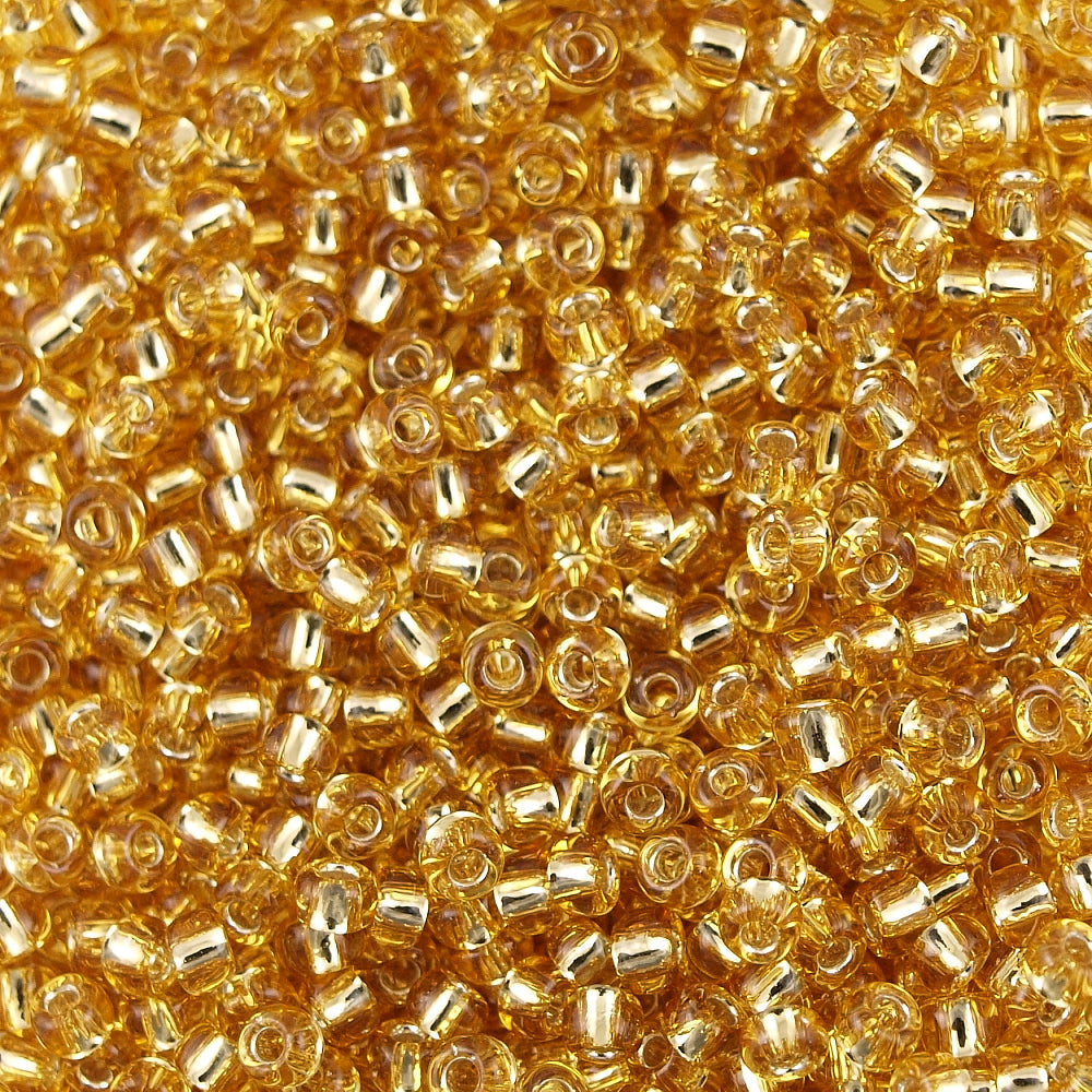 50g Toho Round Seed Bead 11/0 Transparent Silver Lined Gold (22)