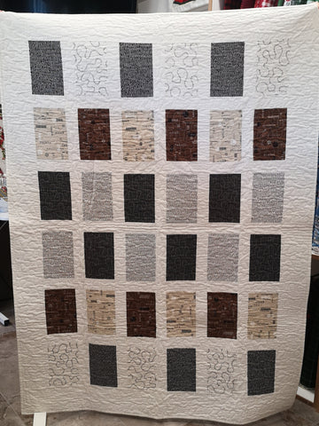 Quick Wordplay Quilt, made of rectangles of fabric with a contrasting border sashing.