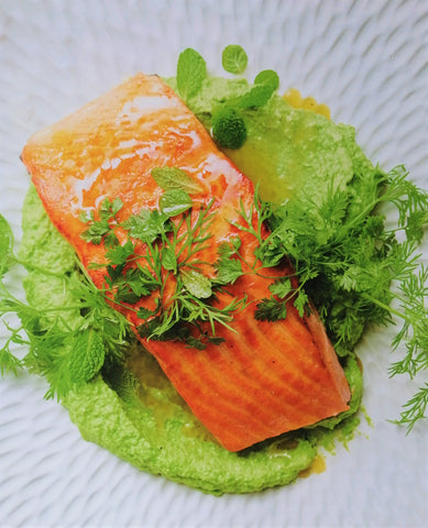 Salmon with pea puree and herb salad