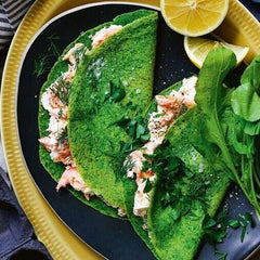 smoked salmon in spinach and herb pancakes