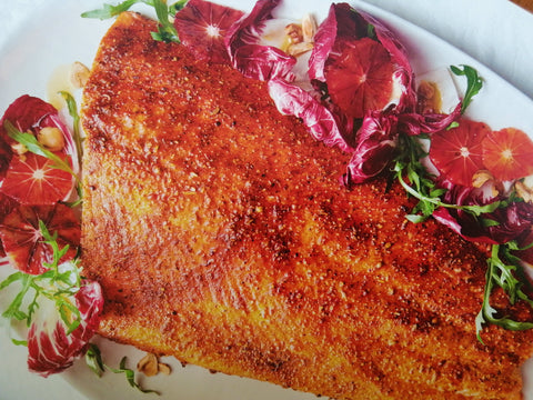 Spice-rubbed salmon with radicchio, blood orange and hazelnuts