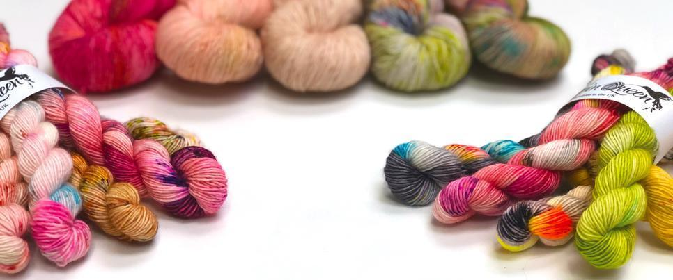 Photo of multicoloured hand dyed yarns in large and mini skeins