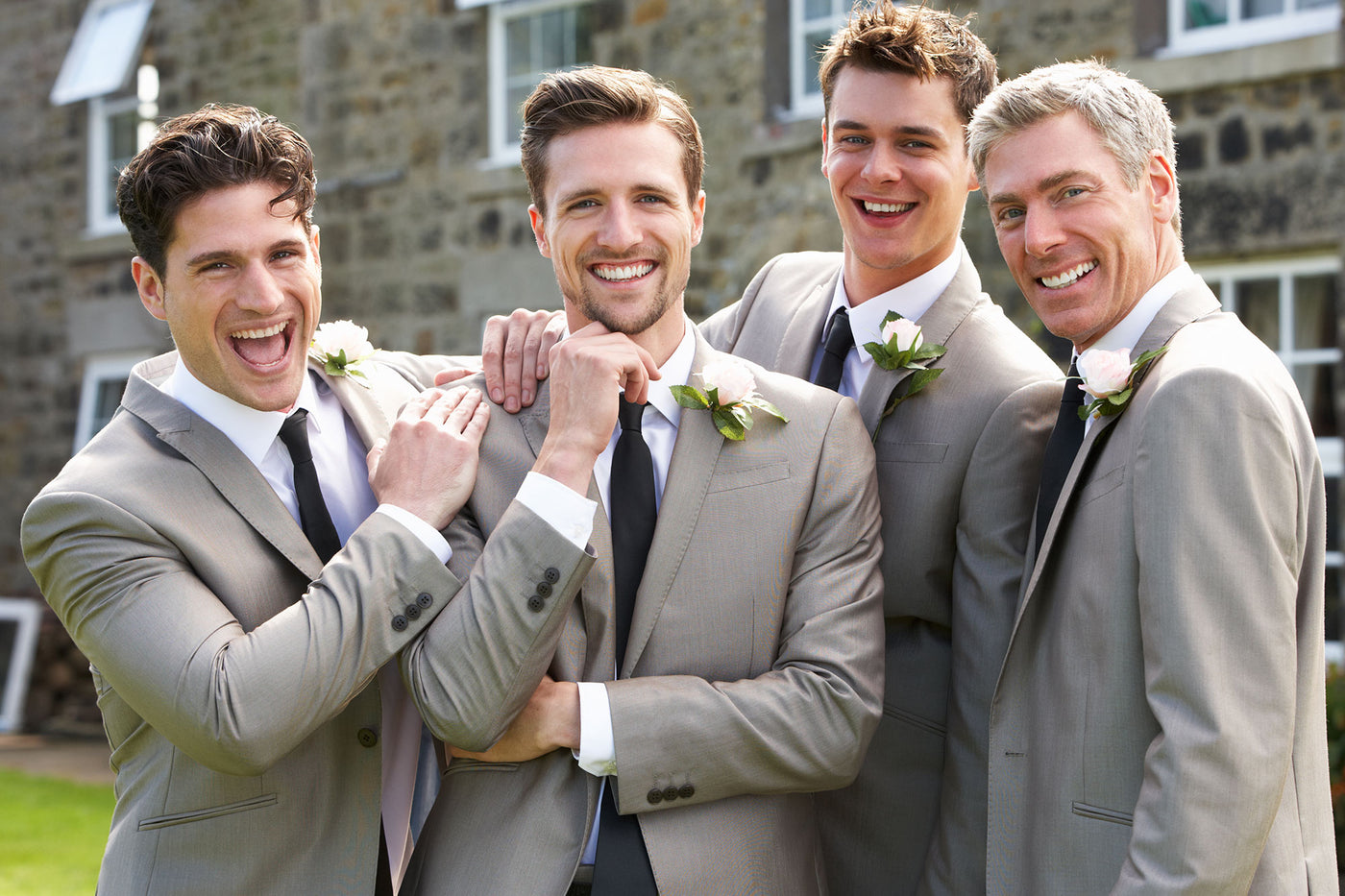The groom and groomsmen in matching motif satin ties