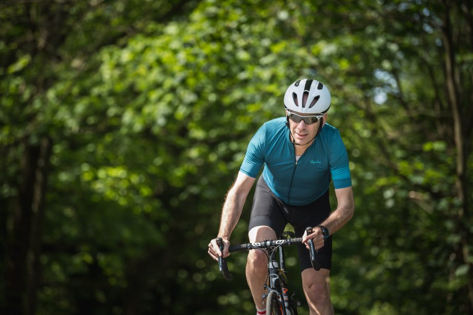 Middle-aged man keeping fit by biking